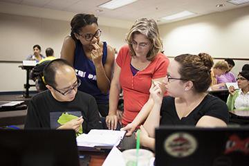 In this biostatistics course, students view online lectures and readings at home and use class time to work on group activities and assignments with instructor Dr. Amy Cantrell on hand to help them work through stumbling blocks.  Photo by Maria Belen Farias.